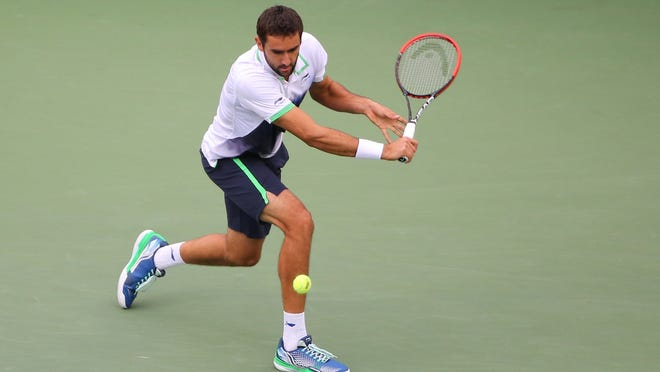 Marin Cilic works his way to a victory over Kei Nishikori in the men's singles final of the U.S. Open on Monday in New York.