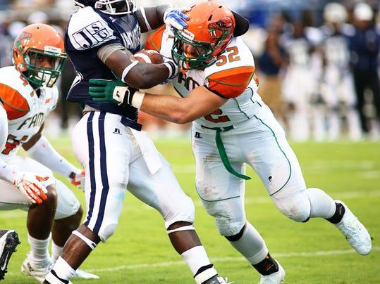 Luke Helms makes a tackle.jpg