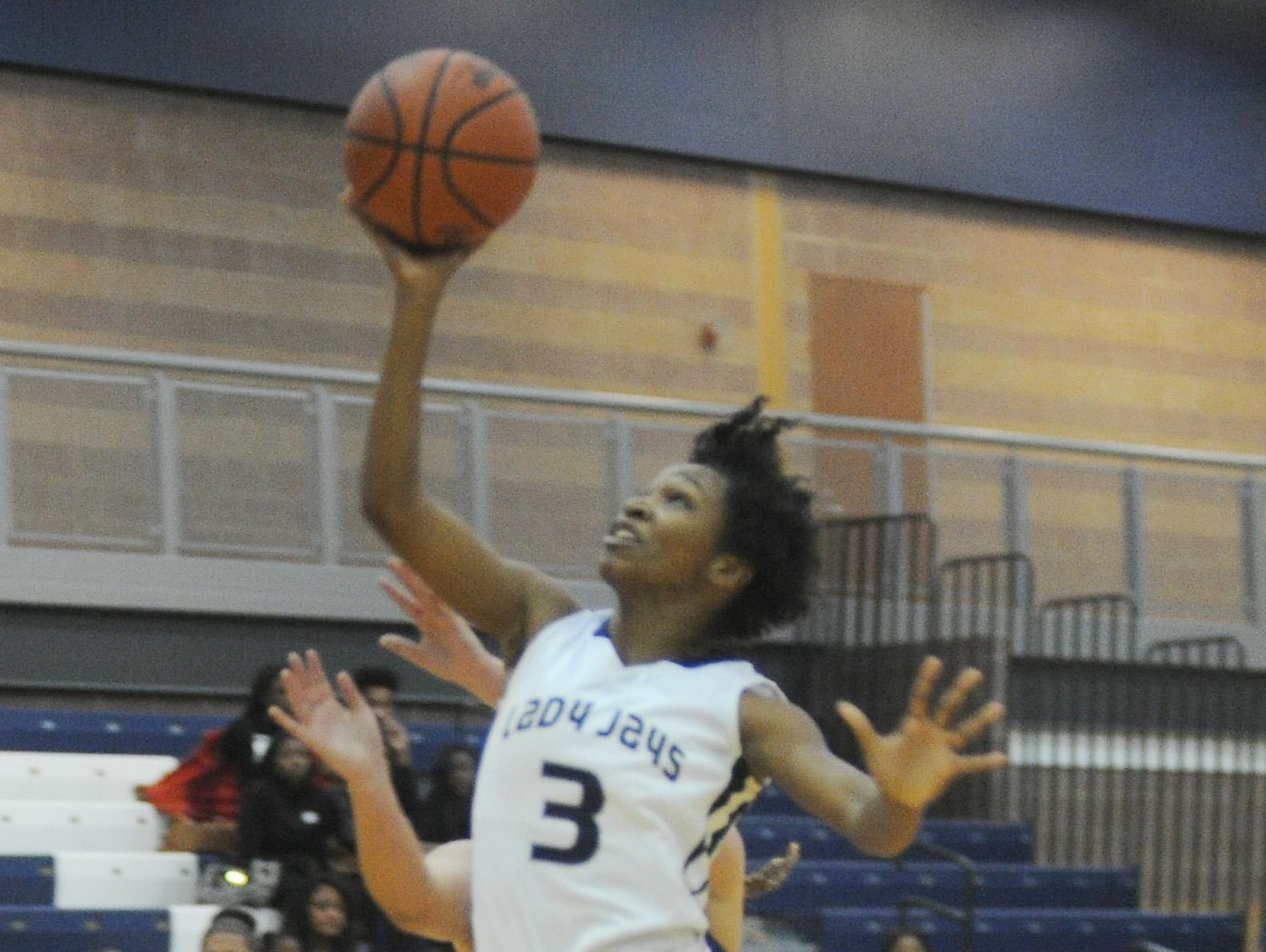 Southfield's Tyler Washington goes to the basket for a layup.