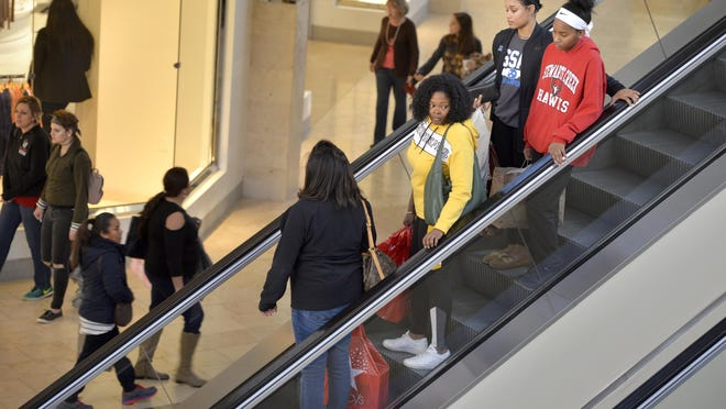 People make their way around the Augusta Mall during Black Friday in this file image from 2018. The COVID-19 pandemic is expected to make the official start of the holiday shopping season more sedate this year.