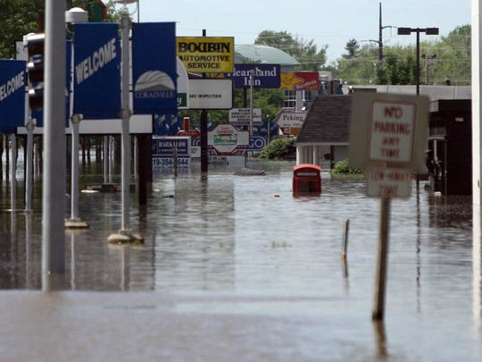Rising floodwaters surround businesses along the Coralville Strip on Friday, June 13, 2008.