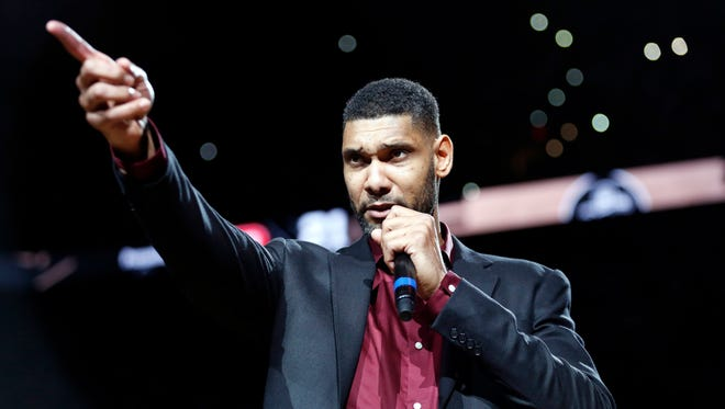 Former San Antonio Spurs power forward Tim Duncan speaks during a ceremony to retire his No. 21 jersey after an NBA basketball game between the Spurs and the New Orleans Pelicans at AT&T Center.