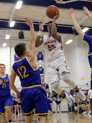Newport's MeKell Burries drives to the basket      during the Wildcats' game against NewCath, Friday, Feb.23,2018.