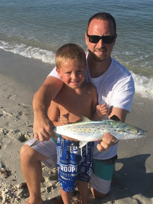 Matt and Grayson Philips caught this Spanish mackeral on a live pilchard the morning of Aug. 6, on Vanderbilt Beach.
