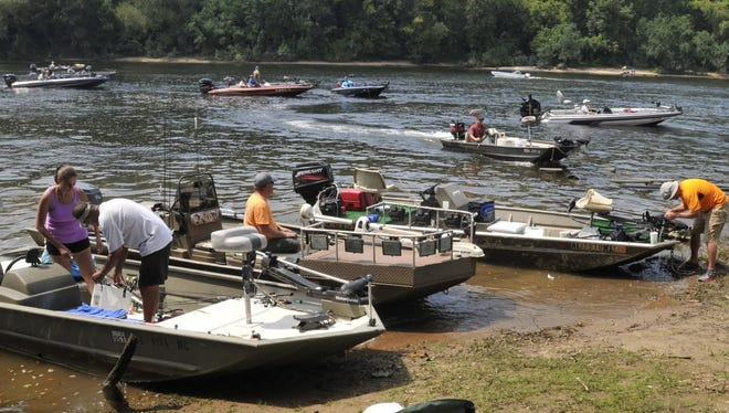 Boats wait in the Coosa River for their trailers at the end of the Rumbling Waters Bass Tournament on Aug. 31, 2013, in Wetumpka.