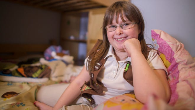 """Haley Helman, a 9-year-old Girl Scout who is sensitive to gluten, finally has a chance to eat one of the cookies she sells now that Toffee-tastic, a gluten-free toffee short- bread, is being debuted. Haley's mom says she """"jumped for joy"""" when she heard the news."""