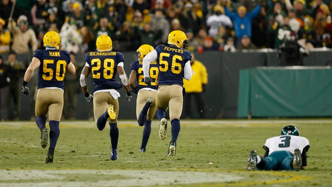 The Packers' Casey Hayward runs a fumble by Eagles quarterback Mark Sanchez for a touchdown during the fourth quarter on Sunday at Lambeau Field in Green Bay, Wisconsin. Sanchez turned the ball over three times with two interceptions in addition to the fumble.