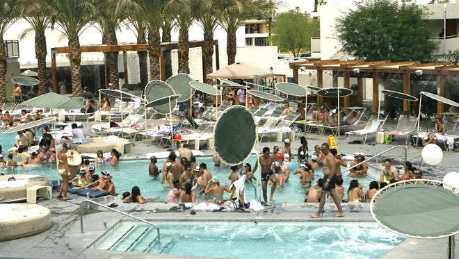 Pool parties like this one in 2012 at the Ace Hotel & Pool Club in Palm Springs are often drive summertime tourism.