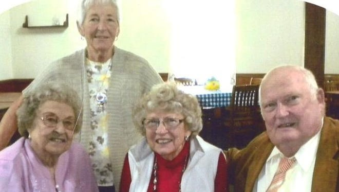 From left, Midge Albert, Alice Von Ahsen (standing), Elberta Lutz and Don Misel gathered for a reunion in Amana recently. Lutz, who taught in Marengo in the 1940s, was a favorite teacher and often thought of through the years by her former students.