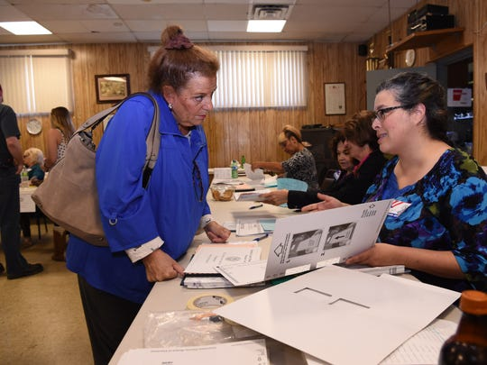 At left, Darene Reilly receives instructions on how to fill out her ballot from election inspector Stefanie Ibanez in Wappingers Falls on Tuesday.