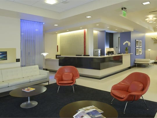 The interior of the new Eisenhower Medical Center on Palm Canyon Drive in Palm Springs, which had been divided into a honeycomb of offices, was gutted and re-purposed with examination rooms and other spaces. Seen here is the lobby, which also includes photographs by Palm Springs photographer Gary Dorothy.