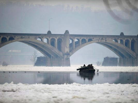 A boat trolls between masses of  ice along the Susquehanna River in Wrightsville Friday, January 10, 2014. The National Weather Service has issued a flood watch for Central Pennsylvania from Saturday afternoon through Sunday evening, warning that warming temperatures will lead to melting and ice break-up on waterways which could lead to ice jams and flooding. Kate Penn -- Daily Record/Sunday News