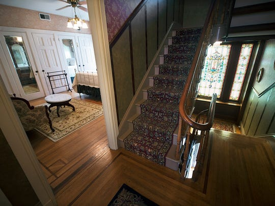 Second floor hall and a bedroom. Paul Kuehnel - Daily Record/Sunday News