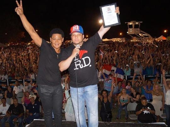 El Jeffrey (left), Irving Lozada and  their friends in Perth Amboy at a previous Perth Amboy Dominican Festival.