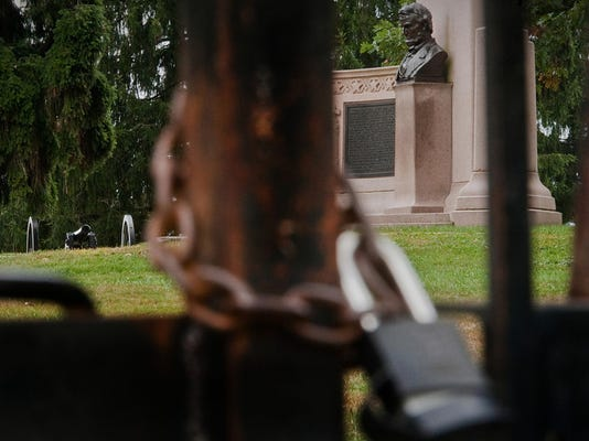 65. A bust of Abe Lincoln appears to watch over a cannon and the padlocked iron gate to Soldiers' National Cemetery in Gettysburg National Military Park. Both the cemetery and park were closed for 17 days in October because of the federal government shutdown. Jeff Lautenberger -- The Evening Sun