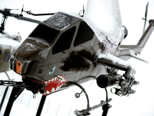 A Cobra helicopter at Ft. Indiantown Gap is covered in ice on Wednesday, Feb. 5, 2014. An ice storm that hit the Lebanon Valley Feb 4-5, 2014. Jeremy Long -- Lebanon Daily News