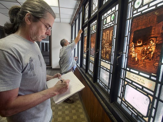 Cliff Maier, left,  and Tim Hirneisen, of Rudy Collective, document the dimensions of the stained glass windows of York colonial history, currently hung of the north addition of the the former Citizens Bank complex. A redevelopment of the former Citizens Bank building on Continental Square in York Monday July 27, 2015. Paul Kuehnel - York Daily Record/ Sunday News