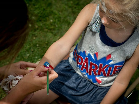 Natalie Klunk, 6, gets an American flag painted on her arm during the Hanover borough sponsored Liberty Day celebration at Moul Field in 2014.