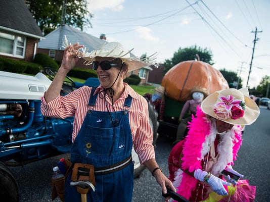 Barb Perich, of Littlestown, laughs while getting ready with members of the Littlestown Garden Club on Wednesday night July 15, 2015 before the start of the Littlestown Founders Day Parade in Littlestown.