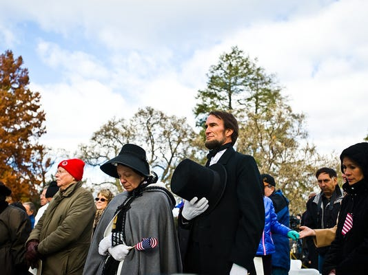 Re-enactor John Voehl and his wife, Pamela Voehl, portray President Abraham Lincoln and Mary Todd Lincoln at the 150th anniversary of the Gettysburg Address in 2013.