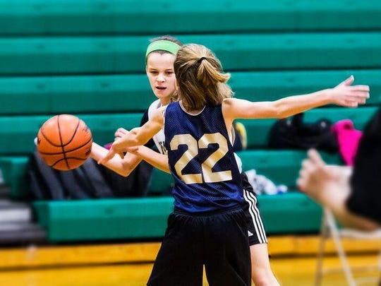 Kelsie Beech of the Be Smart Be Fast Pennfield Girls Basketball League prepares to make a pass around her opponent.