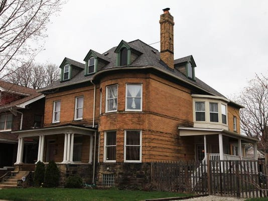 The 3,500-square-foot house was built in 1903, with two layers of brick framing it.