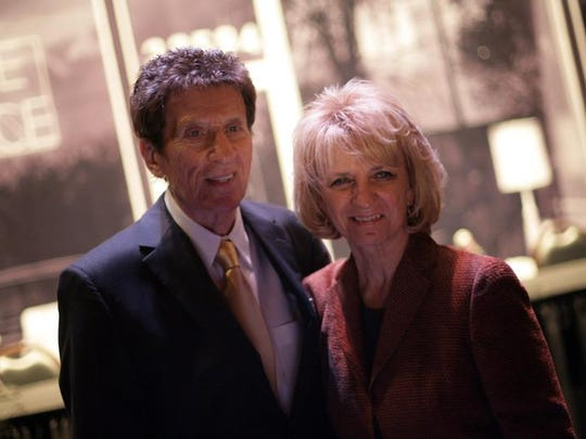 Mike and Marian Ilitch address the media about celebrating the 50-year anniversary of Little Caesars Pizza on Thursday, April 30, 2009, at the Fox Theatre in Detroit.