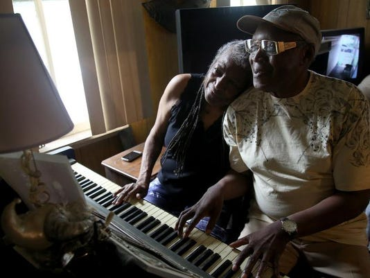 Margaret Terry, 72, plays an old Wurlitzer piano with her brother John Glover, 66, in their rundown childhood home in