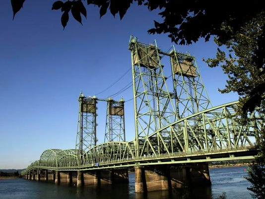 FILE - In this Aug. 4, 2011, file photo, taken in Vancouver, Wash., the Interstate 5 bridge spans the Columbia