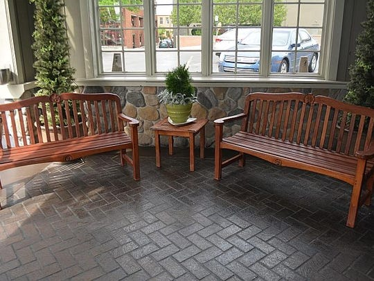 The restaurant's outdoor bench seats and coffee table are listed among the items up for auction.