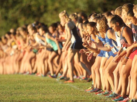 Runners prepare to take off at the start of the girls elite race during October's FSU Invitational at Apalachee Regional Park.