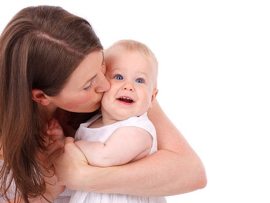 800px-Mother_Kissing_Baby.jpg