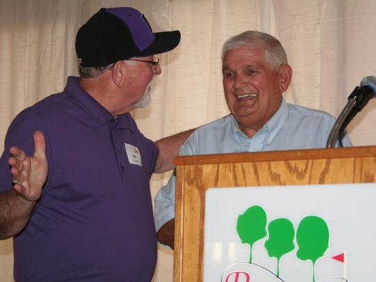 Gary Beard, right, reacts after being introduced by Dick Schlatter after the Gary and Marlene Beard Scholarship was announced.