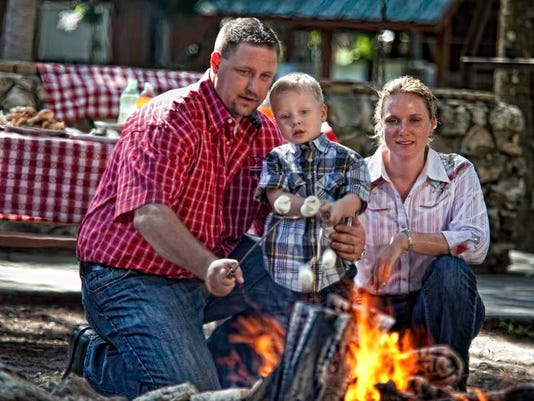 WG River Ranch family by campfire.jpg