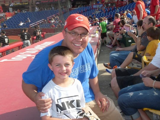 Bill Brassine and his son Will Brassine at the New Haven Tiger Dads Florence Freedom baseball game last May.