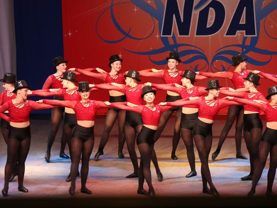 The Ankeny Centennial High School dance team performs its kick routine at the National Dance Alliance National Championship in Orlando, Fla., earlier this month.