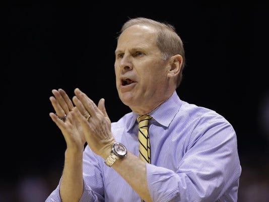 AP_NCAA_Kentucky_Michigan_Ba.jpg