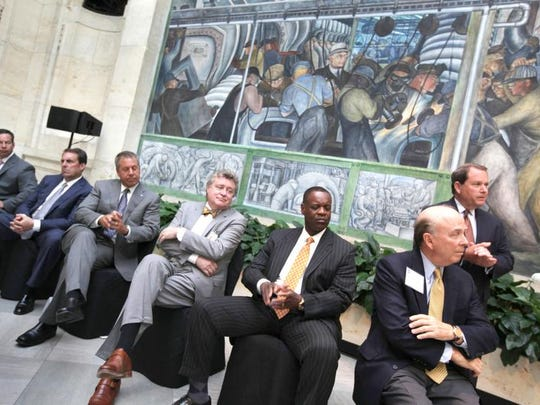 From left, Chrysler executive Reid Bigland,  General Motors' Mark Reuss, Ford Motor Co.'s Joe Hinrichs, Detroit Institute of Arts Director Graham  Beal, Detroit emergency manager Kevyn  Orr, Chief U.S. District Judge Gerald Rosen and DIA Arts Chairman of the Board Eugene Gargaro Jr. listen during a  news conference announcing  pledges to the DIA's  grand bargain commitment in June.