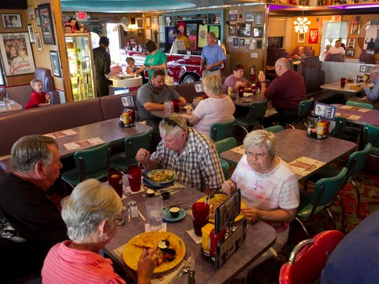 Customers at Mel's Diner eat their lunches on Thursday in Fort Myers.