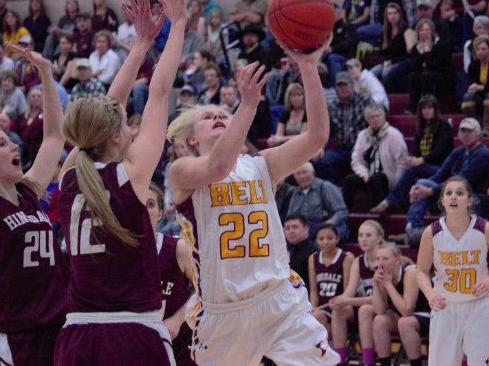 Belt's Katie Fertterer drives to the basket against the Hinsdale defense during State C action Saturday night in Hamilton.