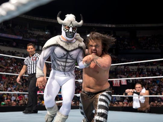 Hornswoggle (right) does battle with El Torito in a WWE match.