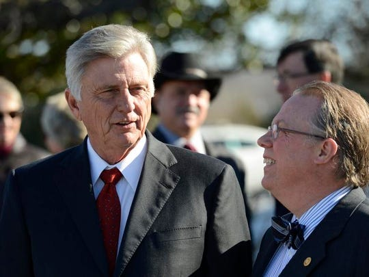 Gov. Mike Beebe talks with Joe Miles (right) in this Bulletin File Photo after the announcement of a job expansion plan at a local manufacturer.