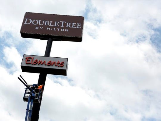 The signs have already changed at the downtown Newark Metropolitan Hotel, but the official switch to DoubleTree by Hilton occurs on July 15.