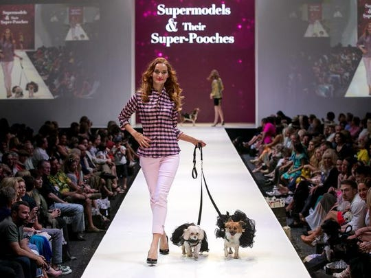Le Chien, a dog fashion show, was held Sunday to launch Fashion Week El Paseo 2014. Dog wear by designer Betty Turner was modeled.