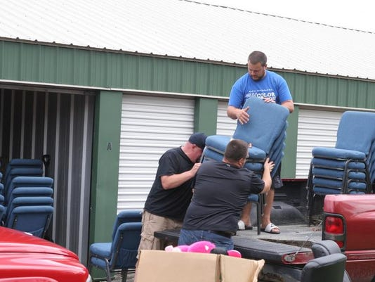 Congregants load chairs headed for the new building.JPG