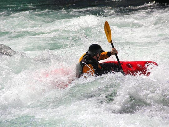Michael Penwell paddles Bullseye rapid on the North Fork of the Middle Fork Willamette River near Oakridge.