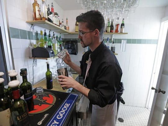 Vivace Restaurant Manager Dustin Humes fixes a drink in a small room that is out of the view of patrons in Salt Lake City. In addition to Utah's quirky drink-mixing laws, the state is about to lower its legal blood-alcohol limit to .05 – the lowest in the nation. Some business owners are saying it will hurt the bottom line.