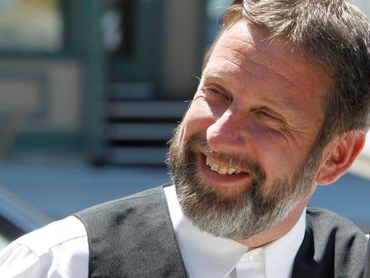Stuarts Draft pastor Kenneth Miller speaks to the media as he heads to court in Burlington, Vt., in 2012.