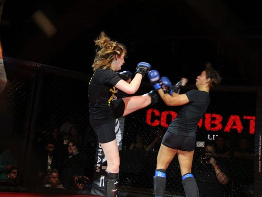 Shelly Price gets a leg up on her opponent.jpg