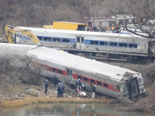 A rail crew works at the scene of the fatal Metro-North train derailment on Dec. 2 in the Bronx near the Spuyten Duyvil station. The Metro-North passenger train derailed en route to New York City near the Spuyten Duyvil station, killing four people and wounding 63 others on Dec. 1. MTA Chief Executive Tom Prendergast said Monday that the cost of positive train control advanced safety systems will not hinder its implementation at Merto-North and Long Island railroads. (Ricky Flores/The Journal News, File)